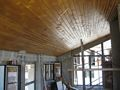 Wooden paneling on the top floor ceiling of a chalet.